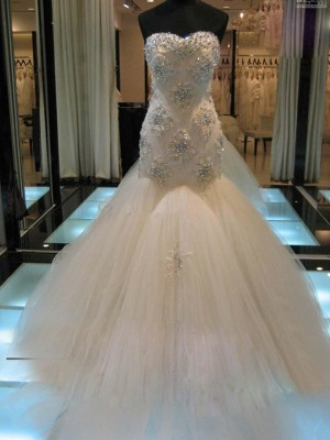 Trumpet/Mermaid Sleeveless Sweetheart Chapel Train Tulle Wedding Dress With Beading